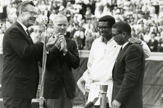 Arthur Ashe celebrates with his father on court after winning the 1968 US Open title.